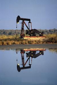 OilDerrickByPond.jpg